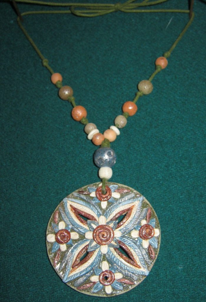"Female decoration ""Flower – crucifix"""