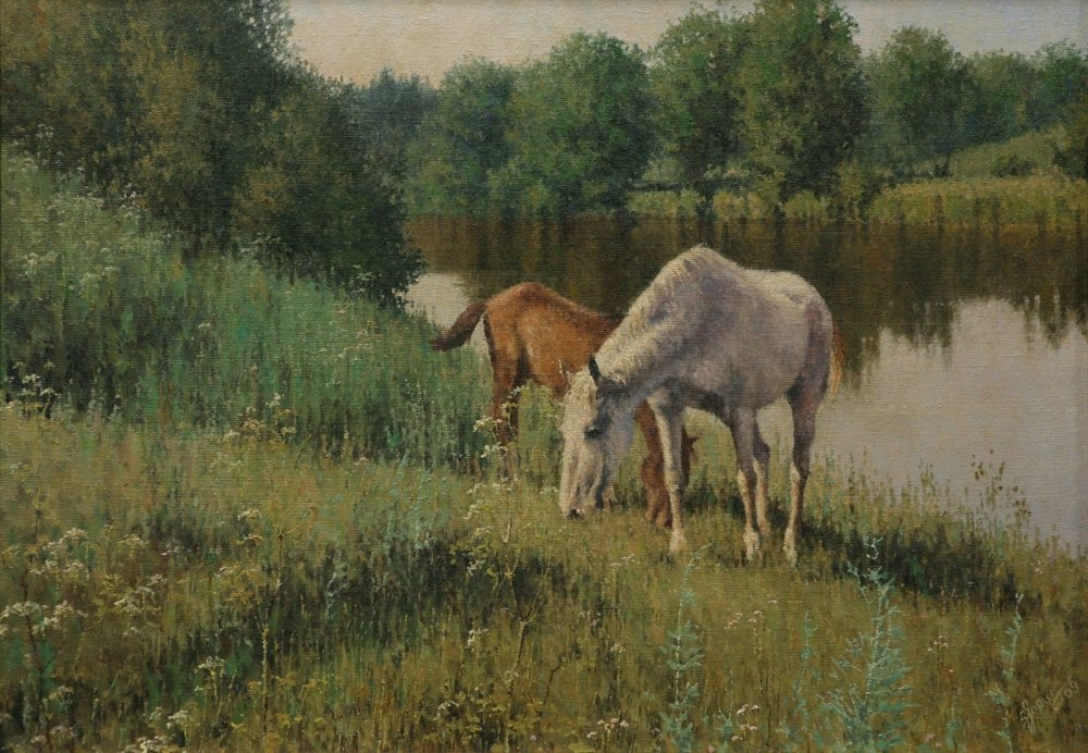 Horses by the pond