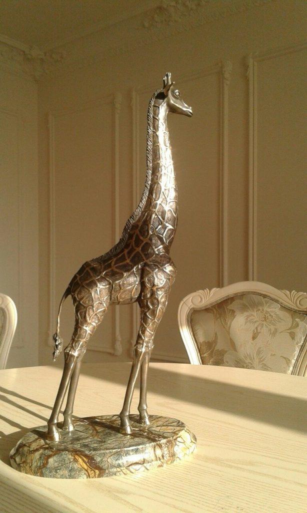 Жираф большой — ему видней